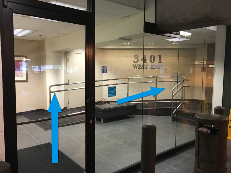 The entrance to the building, which opens to the third floor, is through the glass door inside the parking garage.